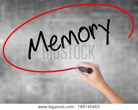 Woman Hand Writing Memory  With Black Marker Over Transparent Board