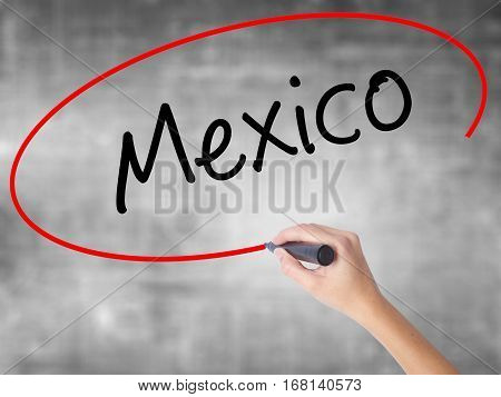 Woman Hand Writing Mexico  With Black Marker Over Transparent Board