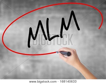 Woman Hand Writing  Mlm (multi-level Marketing) With Black Marker Over Transparent Board