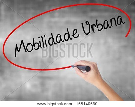 Woman Hand Writing Mobilidade Urbana (urban Mobility In Portuguese With Black Marker Over Transparen