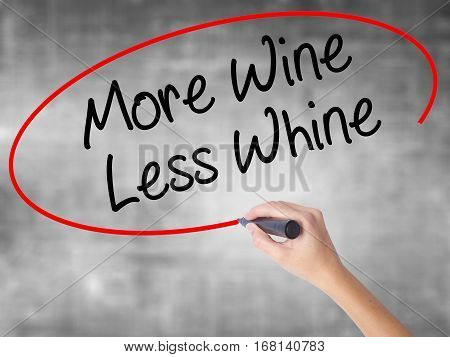 Woman Hand Writing More Wine Less Whine With Black Marker Over Transparent Board