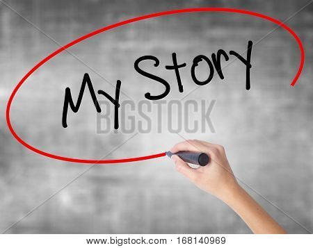 Woman Hand Writing My Story With Black Marker Over Transparent Board