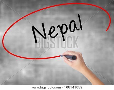Woman Hand Writing Nepal  With Black Marker Over Transparent Board