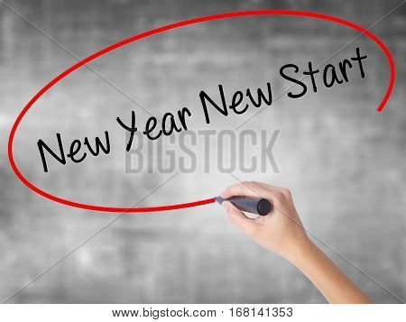 Woman Hand Writing New Year New Start With Black Marker Over Transparent Board
