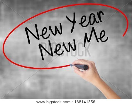 Woman Hand Writing New Year New Me With Black Marker Over Transparent Board