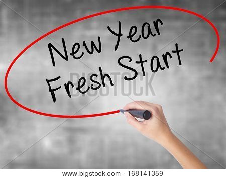 Woman Hand Writing New Year Fresh Start With Black Marker Over Transparent Board