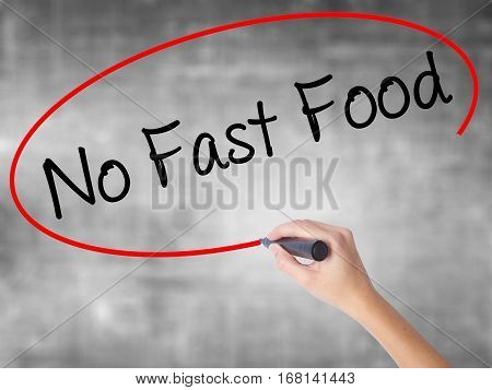 Woman Hand Writing No Fast Food With Black Marker Over Transparent Board.