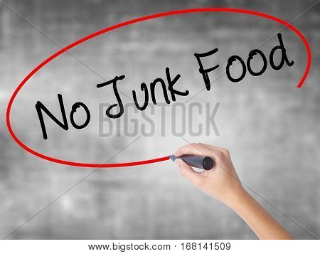 Woman Hand Writing No Junk Food With Black Marker Over Transparent Board