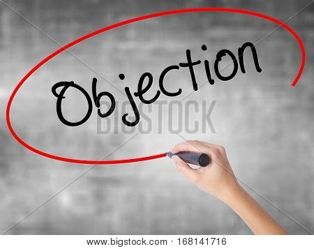 Woman Hand Writing Objection With Black Marker Over Transparent Board