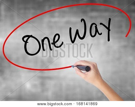 Woman Hand Writing One Way With Black Marker Over Transparent Board.