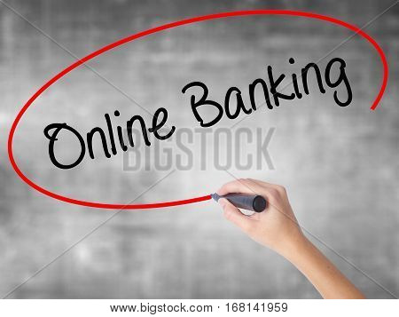 Woman Hand Writing Online Banking With Black Marker Over Transparent Board
