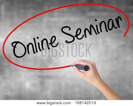Woman Hand Writing Online Seminar With Black Marker Over Transparent Board