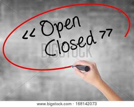 Woman Hand Writing Open - Closed With Black Marker Over Transparent Board