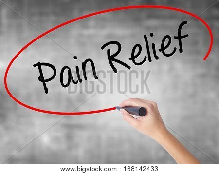 Woman Hand Writing Pain Relief With Black Marker Over Transparent Board