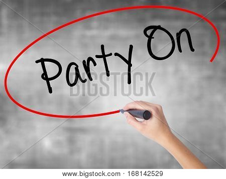 Woman Hand Writing Party On With Black Marker Over Transparent Board