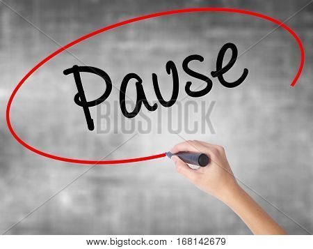 Woman Hand Writing Pause With Black Marker Over Transparent Board