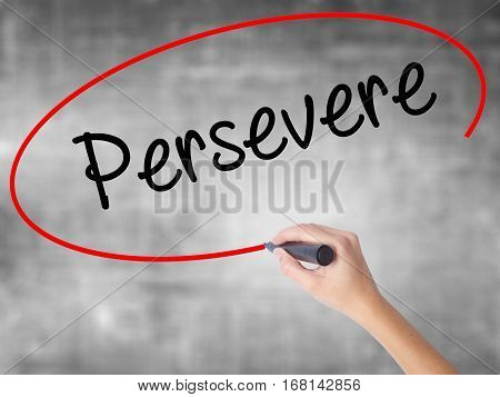 Woman Hand Writing Persevere With Black Marker Over Transparent Board.