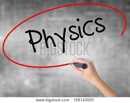 Woman Hand Writing Physics With Black Marker Over Transparent Board