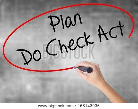 Woman Hand Writing Plan Do Check Act  With Black Marker Over Transparent Board