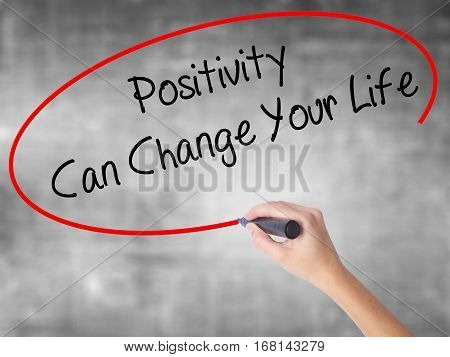 Woman Hand Writing Positivity Can Change Your Life With Black Marker Over Transparent Board