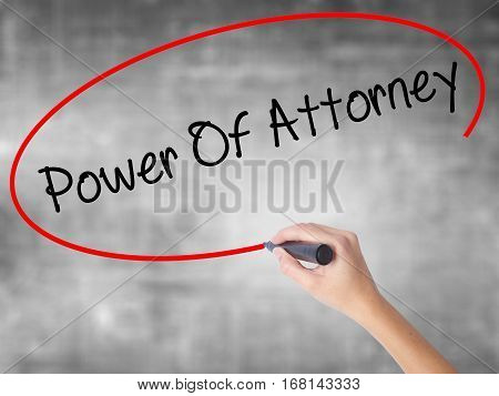 Woman Hand Writing Power Of Attorney With Black Marker Over Transparent Board