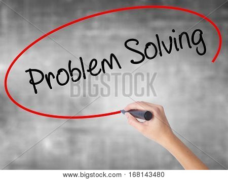 Woman Hand Writing Problem Solving With Black Marker Over Transparent Board