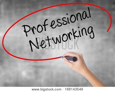 Woman Hand Writing Professional Networking With Black Marker Over Transparent Board