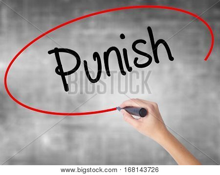 Woman Hand Writing Punish With Black Marker Over Transparent Board.