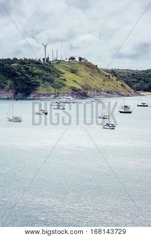 Sailboats in the bay. Yachts at the pier in bad weather. Rain season