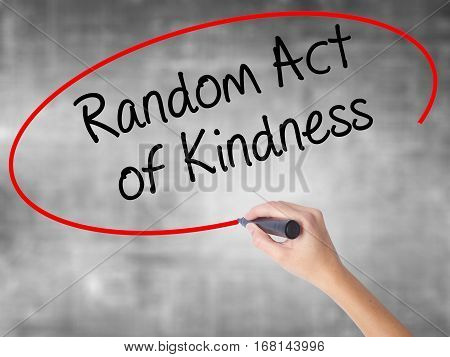 Woman Hand Writing Random Act Of Kindness With Black Marker Over Transparent Board