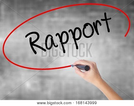 Woman Hand Writing Rapport With Black Marker Over Transparent Board