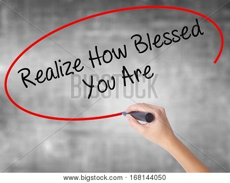 Woman Hand Writing  Realize How Blessed You Are  With Black Marker Over Transparent Board