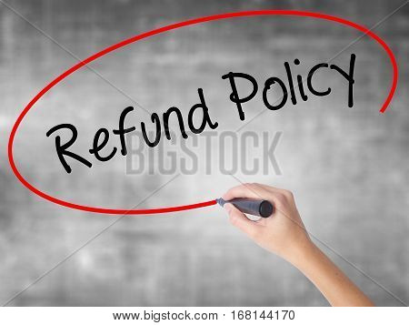 Woman Hand Writing Refund Policy With Black Marker Over Transparent Board