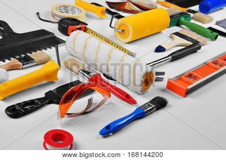 Set of professional decorator equipment on white background