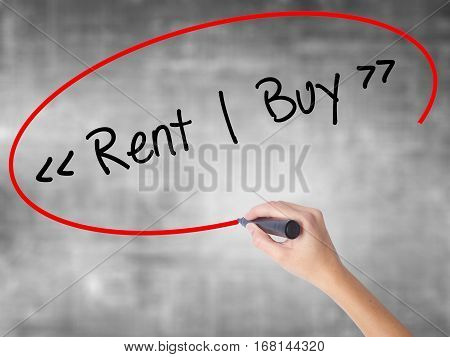 Woman Hand Writing Rent - Buy  With Black Marker Over Transparent Board.