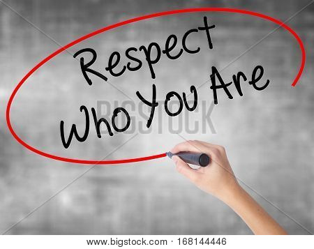 Woman Hand Writing Respect Who You Are With Black Marker Over Transparent Board.