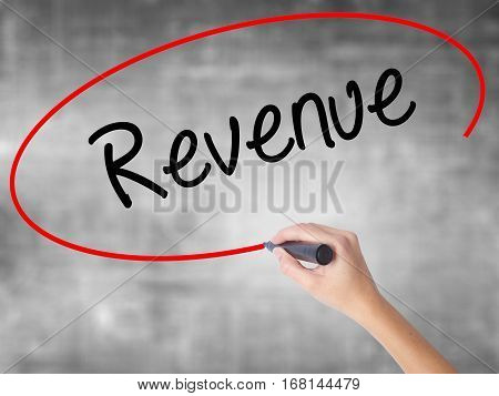 Woman Hand Writing Revenue With Black Marker Over Transparent Board