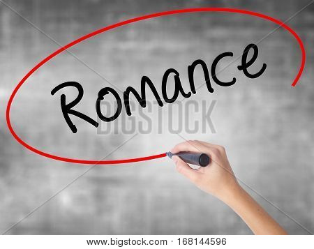 Woman Hand Writing Romance With Black Marker Over Transparent Board