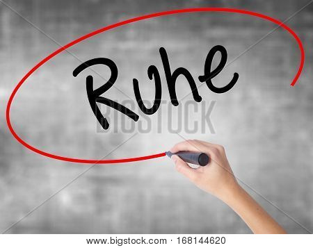 Woman Hand Writing Ruhe (quiet In German) With Black Marker Over Transparent Board