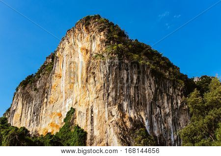 Rock on a background of blue sky. Great mountain