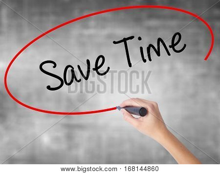 Woman Hand Writing Save Time With Black Marker Over Transparent Board