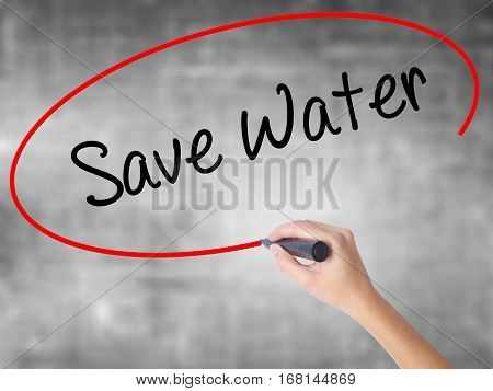 Woman Hand Writing Save Water  With Black Marker Over Transparent Board