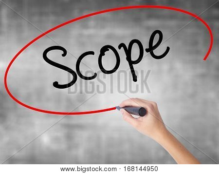 Woman Hand Writing Scope With Black Marker Over Transparent Board