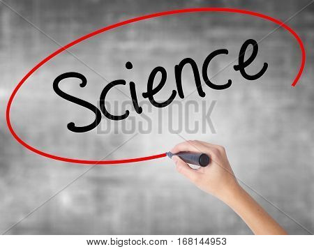 Woman Hand Writing Science With Black Marker Over Transparent Board