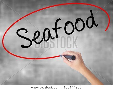 Woman Hand Writing Seafood With Black Marker Over Transparent Board