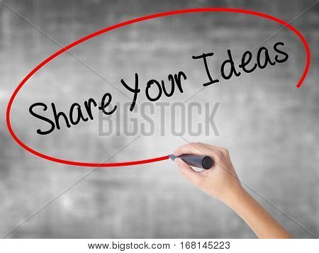 Woman Hand Writing Share Your Ideas With Black Marker Over Transparent Board