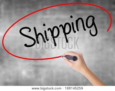 Woman Hand Writing Shipping With Black Marker Over Transparent Board.