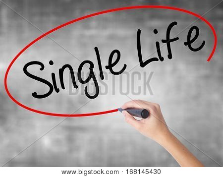 Woman Hand Writing Single Life With Black Marker Over Transparent Board