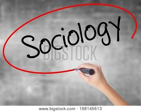Woman Hand Writing Sociology  With Black Marker Over Transparent Board
