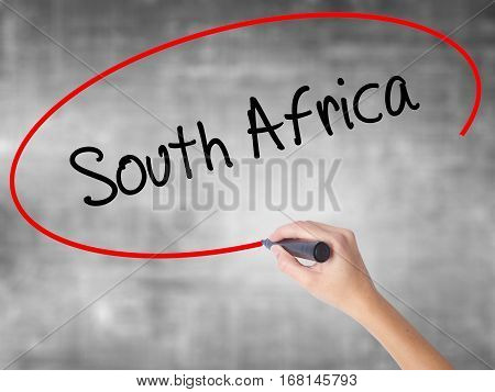 Woman Hand Writing South Africa With Black Marker Over Transparent Board